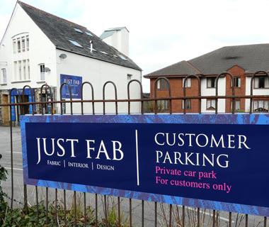Exterior wayfinding signage for Just Fab Design's carpark