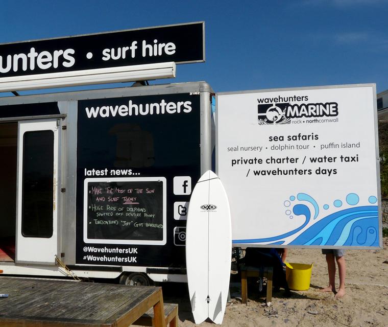 Trailer graphics design at Polzeath Beach for Wavehunters Surf School