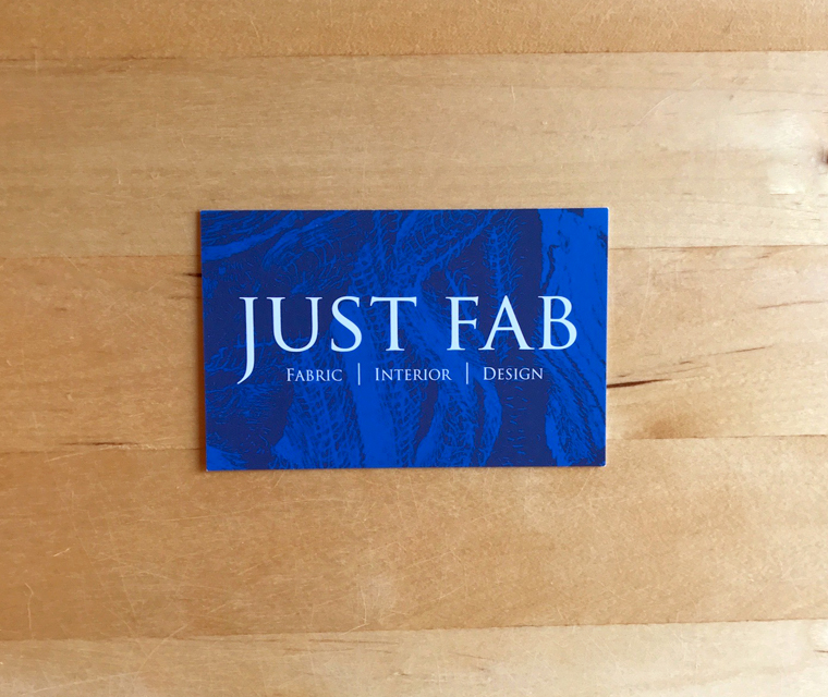 Just Fab business card with vibrant blue abstract pattern