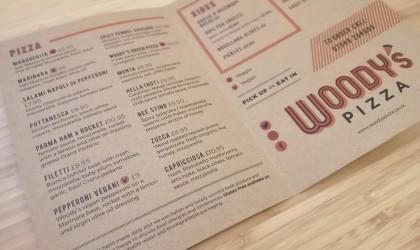 Woody's Pizza menu printed on brown paper