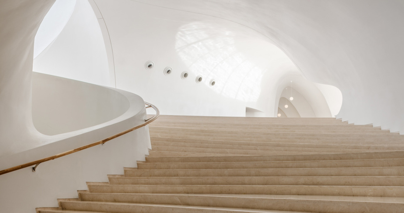 Wooden steps and curved white interior in amazing architecture