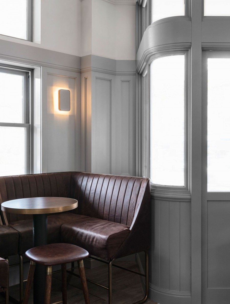 Brown leather and curved wood panelling