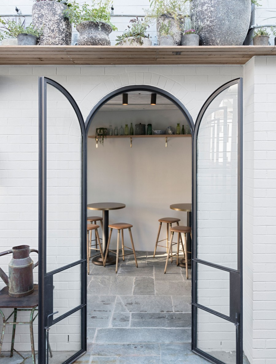 Arched doorway with white tiles