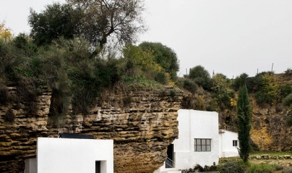 Cave house in spain with white modern cube additions