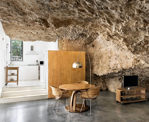 Rough rock walls and modern furniture