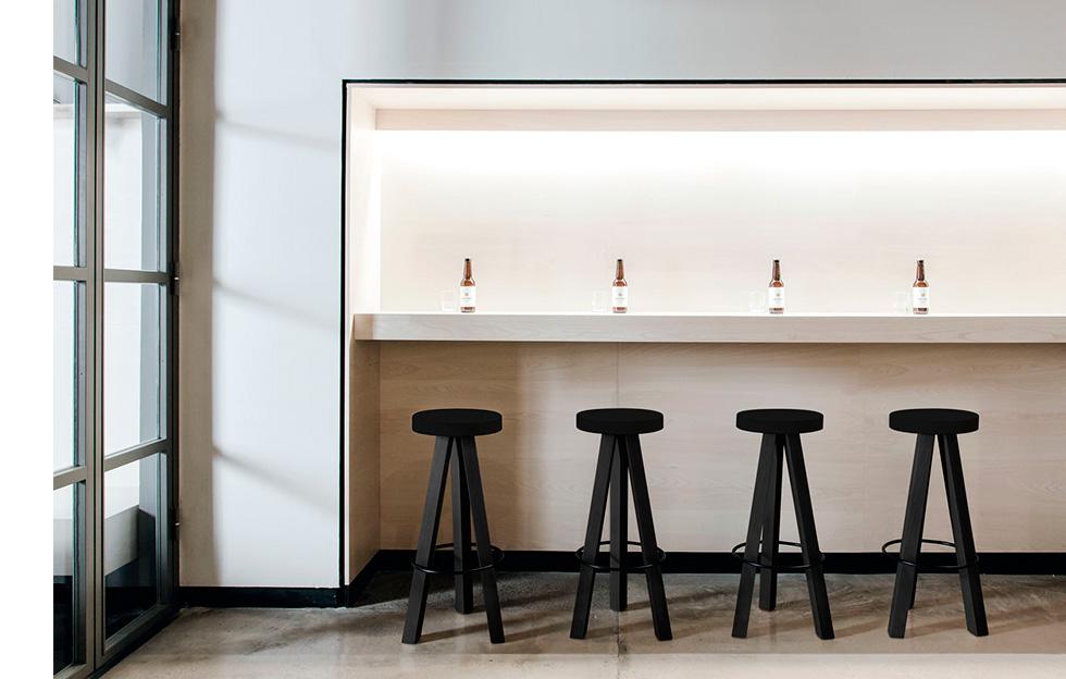 Black three legged bar stools