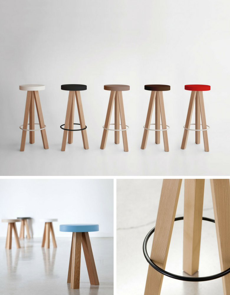 Three legged stool with bright coloured seat and oak legs