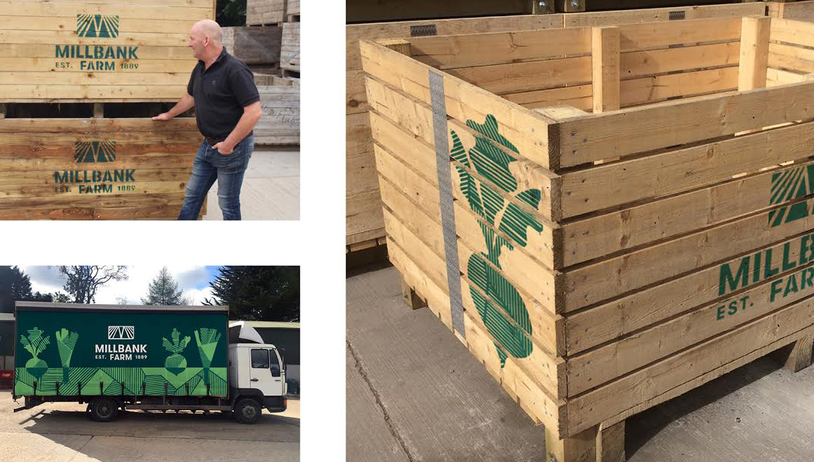 applying a brand to a lorry and wooden pallets