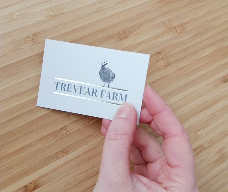 Business card design for Trevear Farm featuring silver foil
