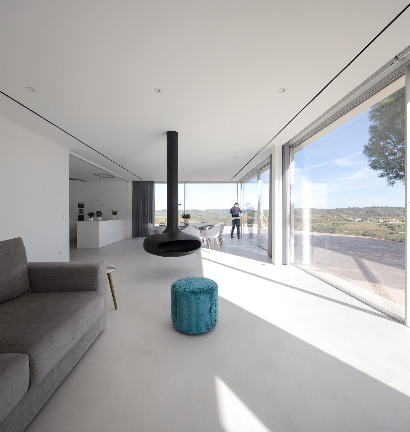 Portuguese Modernist white house with ceiling mounted fire