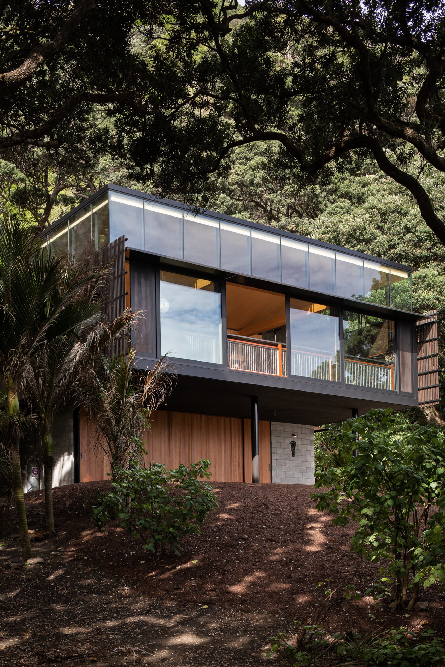 Giant boxy home high in the trees with sea views